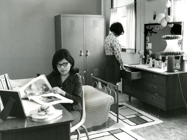 Navajo girls in a dorm room, c. 1960s. Nellie Boyd at left and Mary Grey at right.