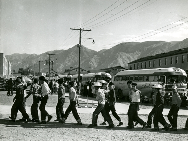 Students arriving at school in August, 1953.