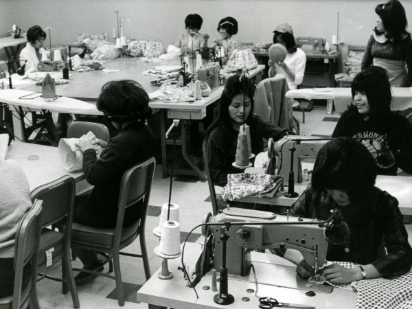 Sewing was popular with girls at the school. While the school did not provide money for clothing, girls could make their own clothes in sewing class, c. 1967.