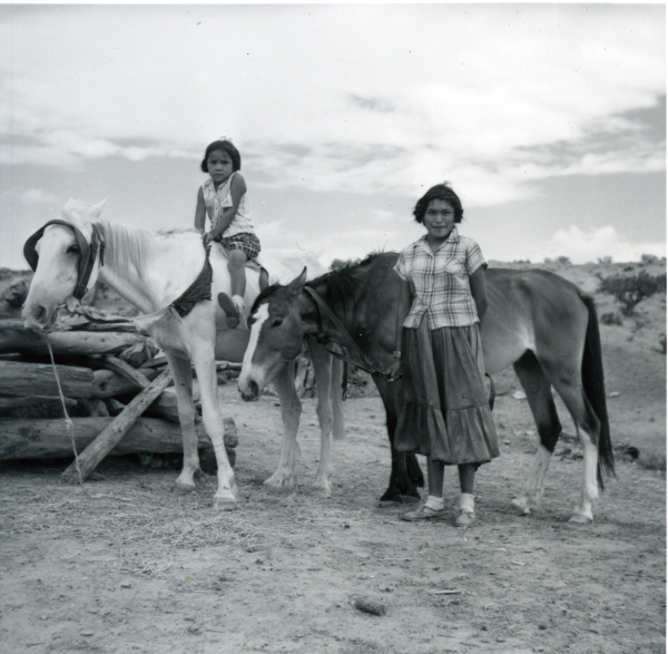 Lydia Rose Betoni (standing) and her younger sister at home on the Navajo Reservation. Lydia attended Intermountain in 1959, while her younger sister attended a local Mission School. Photo by M.H. Trujillo.