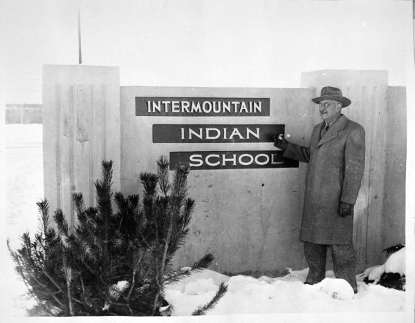 Dr. Boyce standing in front of the IIS sign.