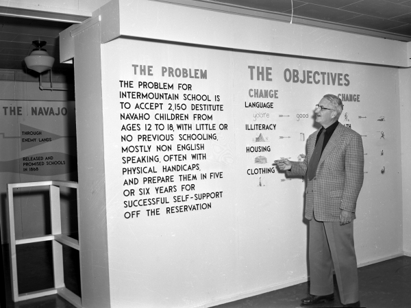 Superintendent George Boyce points to a wall explaining the problems faced by early IIS students, c. 1952. Photos by Bernice Gibbs Anderson.