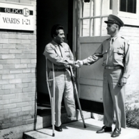 Dr. Robert D. Smith shaking hands with the last patient to leave Bushnell, 1946.