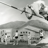An IIS student makes his mark during a track meet against Roy High School, c. 1967.