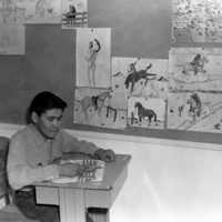 A boy drawing in a classroom, c. 1952. Photo by Bernice Gibbs Anderson.