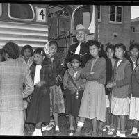 Dr. Boyce with girls in line for the bus.